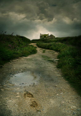 Lyn Randle DISTANT COTTAGE WITH EMPTY LANE AND STORMY SKY
