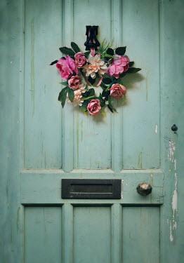 Lyn Randle WREATH OF PINK FLOWERS ON WEATHERED DOOR