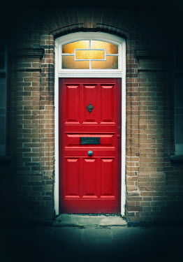 Lyn Randle LIGHT SHINING IN BRICK HOUSE WITH RED DOOR