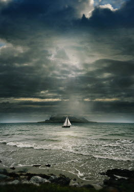 Lyn Randle YACHT SAILING BY ISLAND WITH STORMY SKY