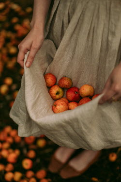 Rebecca Stice GIRL CARRYING APPLES IN DRESS