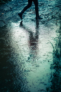 Magdalena Russocka close up of woman running by puddle in rain