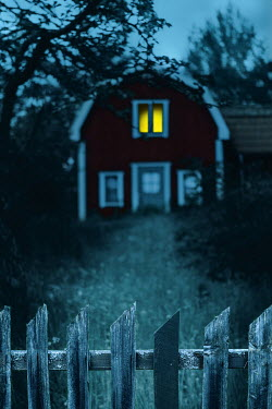 Magdalena Russocka swedish cottage house with light in window at night