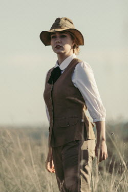 Magdalena Russocka vintage woman wearing safari outfit standing in field