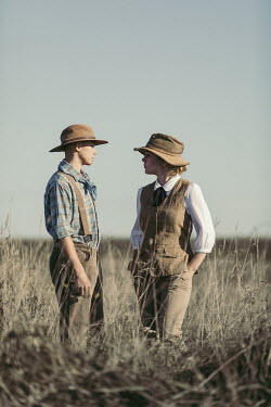 Magdalena Russocka vintage couple wearing safari outfits standing in field
