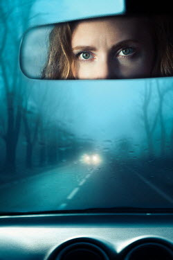 Magdalena Russocka woman's eyes reflected in car rearview mirror
