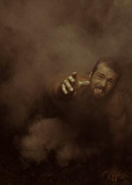 Ekaterina Pavlova MAN LYING ON GROUND IN SMOKE