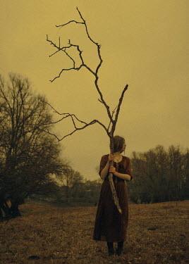 Ekaterina Pavlova Young woman holding branch