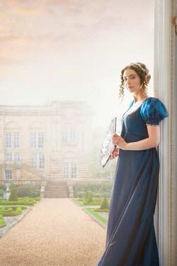 Lee Avison regency woman leaning on a doorframe
