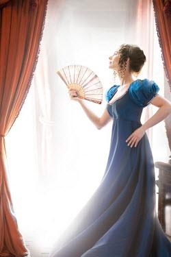 Lee Avison regency woman with fan at the window