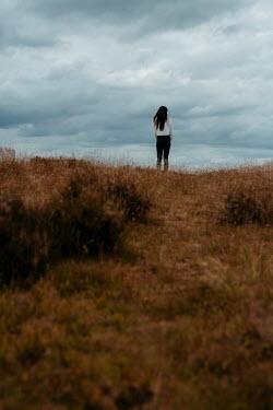 Shelley Richmond Young woman walking in field