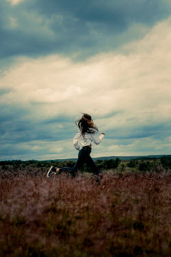 Shelley Richmond Young woman running in field