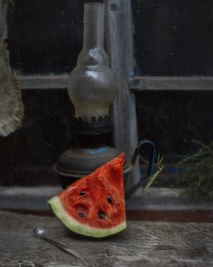 Andreeva Svoboda Watermelon and lamp on window sill