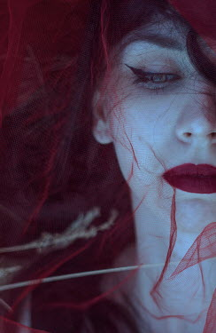 Daria Amaranth Dead young woman with red lipstick behind netting