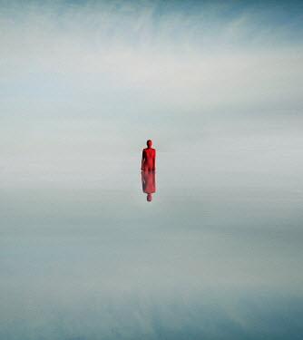 Felicia Simion Woman in red bodysuit in lake