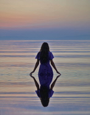 Felicia Simion Young woman in lake at sunset