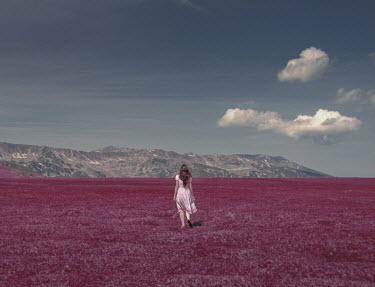 Felicia Simion Woman walking in field to mountain