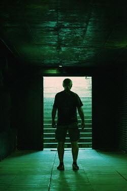 Kerstin Marinov Man standing in tunnel