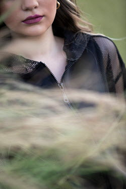 Mohamad Itani Young woman behind grass