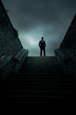 Miguel Sobreira Man in suit standing by stone steps