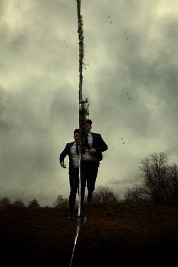 Miguel Sobreira Man in suit running in field