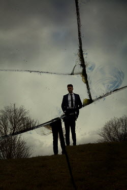 Miguel Sobreira Man in suit standing on hill