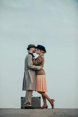 Magdalena Russocka retro couple embracing on road