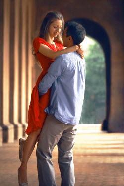 ILINA SIMEONOVA Couple embracing under portico