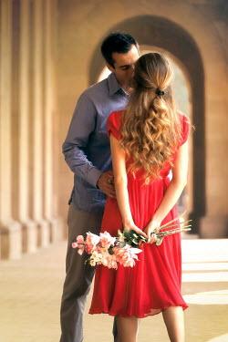 ILINA SIMEONOVA Couple kissing under portico