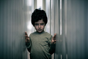 Mohamad Itani Boy standing in alley