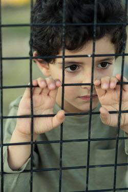 Mohamad Itani Boy behind fence