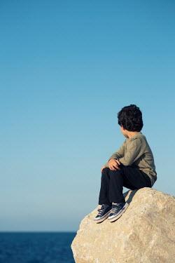 Mohamad Itani Boy sitting on rock