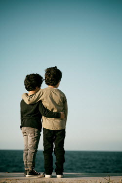 Mohamad Itani Brothers standing by sea
