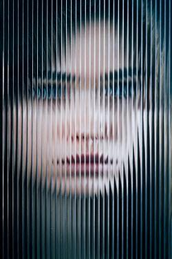 Magdalena Russocka close up of woman behind distortrd glass