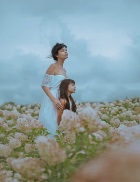 Svitozar Bilorusov Mother and daughter in field of flowers
