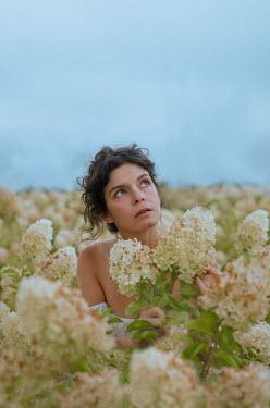 Svitozar Bilorusov Woman in field of flowers