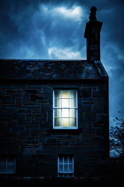 Natasza Fiedotjew old stone brick house with light in window at night