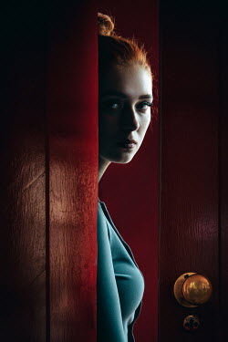 Natasza Fiedotjew young woman peeking through ajar door
