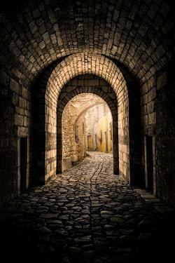 Evelina Kremsdorf Tunnel and cobblestone road in Italy