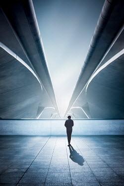 Evelina Kremsdorf Man walking under bridges