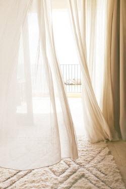 ILINA SIMEONOVA Curtains, balcony, and rocks on sea