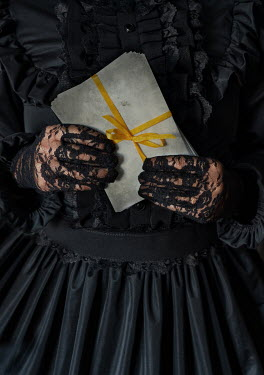 Jaroslaw Blaminsky Hands of woman with lace gloves holding envelopes