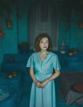 Svitozar Bilorusov Young woman in blue dress standing by doorway