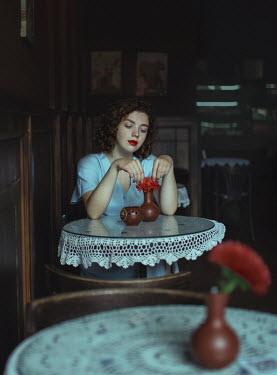 Svitozar Bilorusov Young woman sitting at cafe table