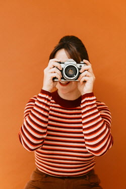 Shelley Richmond Young woman in striped sweater with camera