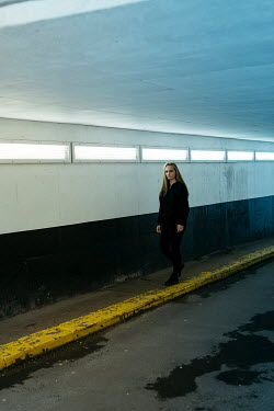 Shelley Richmond Young woman walking in tunnel