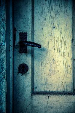 Natasza Fiedotjew Old wooden door with rusty handle and keyhole