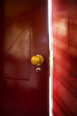 Natasza Fiedotjew sun shining through red door ajar