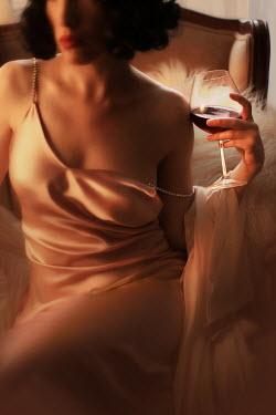 ILINA SIMEONOVA 1920s young woman holding wine glass
