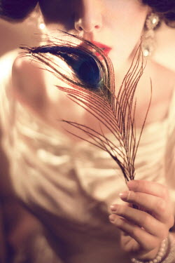 ILINA SIMEONOVA 1920s young woman holding peacock feather